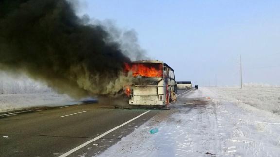 The blazing bus on Thursday morning in Kazakhstan's region of Aktobe.