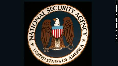 The seal of the National Security Agency (NSA) hangs at the Threat Operations Center inside the NSA in the Washington suburb of Fort Meade, Maryland, 25 January 2006. US President George W. Bush delivered a speech behind closed doors and met with employees in advance of Senate hearings on the much-criticized domestic surveillance. / AFP PHOTO / Paul J. RICHARDS        (Photo credit should read PAUL J. RICHARDS/AFP/Getty Images)