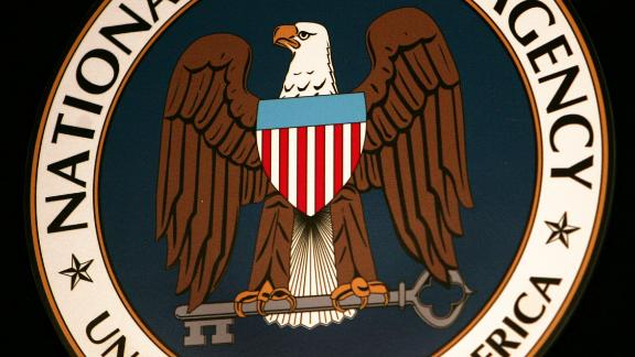 The seal of the National Security Agency (NSA) hangs at the Threat Operations Center inside the NSA.