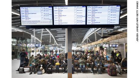 Passengers wait at Utrecht Central Station in the Netherlands as windstorms forced the cancelation of train services Thursday.