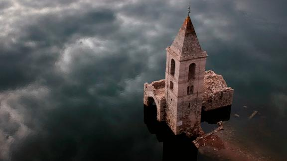 Vilanova de Sau, Catalonia, Spain: The eerie remains of an ancient village are seen inside the reservoir of Sau, in Vilanova de Sau, Catalonia, Spain. The reservoir usually covers this 11th-century Romanesque church -- but in January the waters were so low that the building was uncovered.
