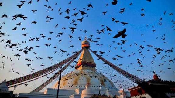 Boudhanath Stupa, Kathmandu, Nepal: Pigeons fly above the UNESCO heritage site of Boudhanath Stupa, in Kathmandu, Nepal.