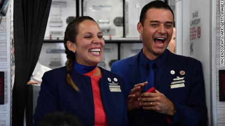 Crew members Paula Podest and Carlos Ciuffardi celebrate after being married by Pope Francis.