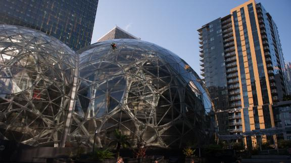 Attendees gather outside of the Amazon.com Inc. Spheres ahead of the company's product reveal launch event in downtown Seattle, Washington, U.S., on Wednesday, Sept. 27, 2017. Amazon will unveil new gadgets at an event in Seattle, joining the rush of technology products vying for consumers' attention as the holiday shopping season approaches. Photographer: Daniel Berman/Bloomberg via Getty Images