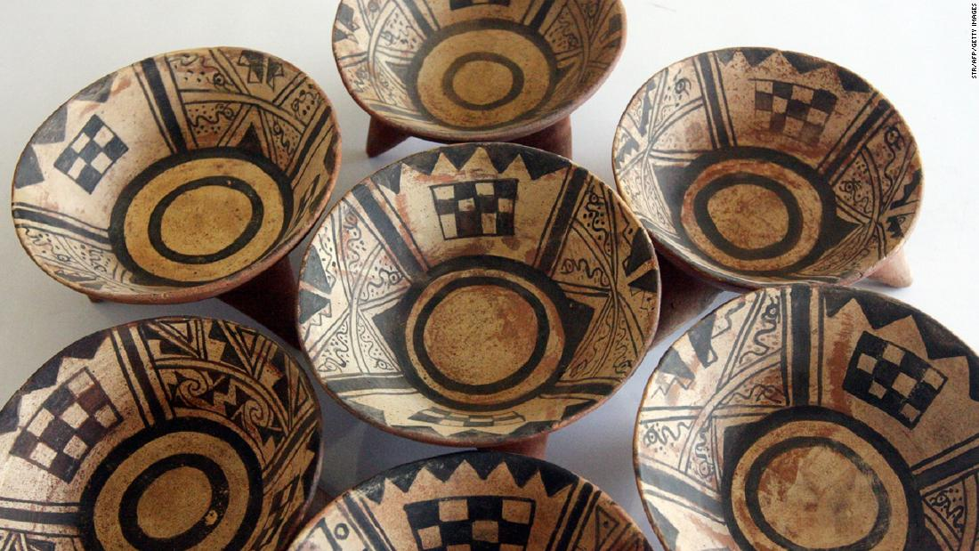 Most Moche vessels were decorated with symbolic shapes and patterns, painted red and black on a cream background.