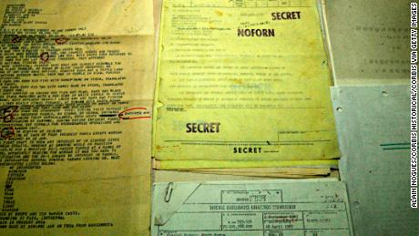 Top secret files recovered from the USS Pueblo seen in a propaganda photo released by North Korea.