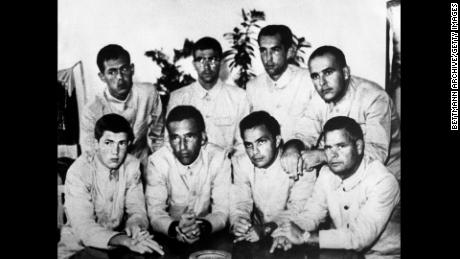 The USS Pueblo crew display their middle fingers in propaganda photos put out by their captors.