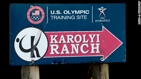 A sign points down the road to the Karolyi Ranch in New Waverly, Texas.