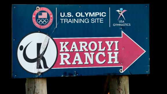 A sign points down the road to the Karolyi Ranch Saturday, Sept. 12, 2015, in New Waverly, Texas. (AP Photo/David J. Phillip)