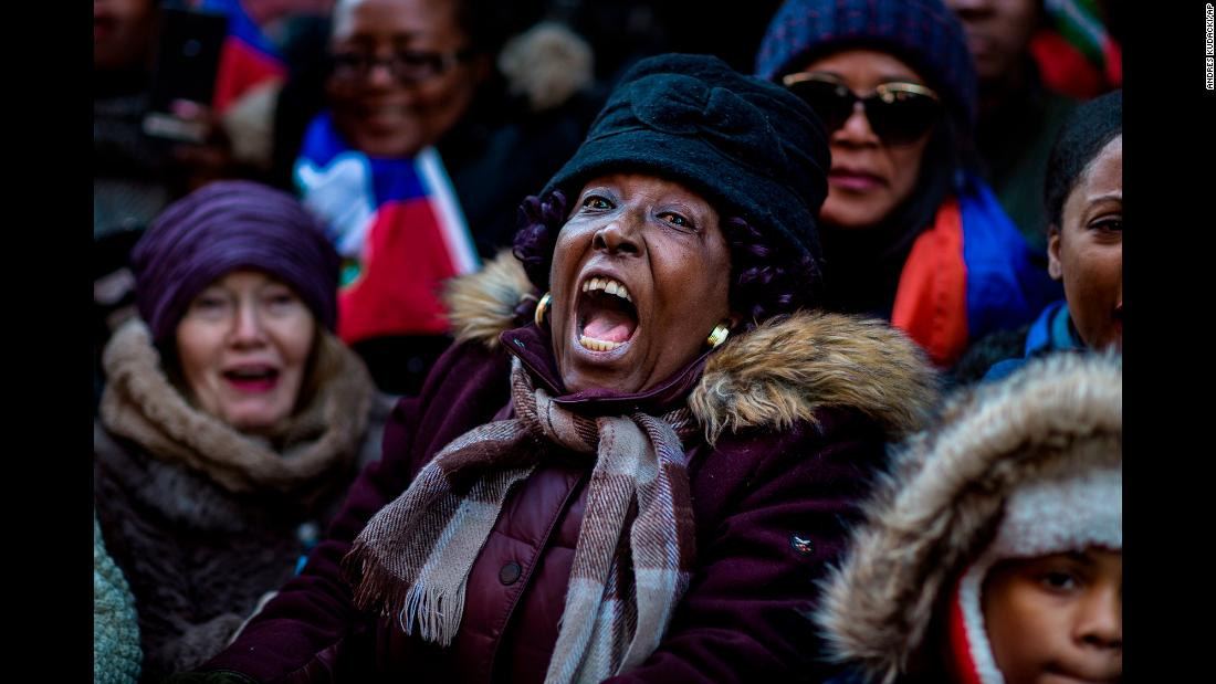 "A woman joins in an anti-racism rally in New York on Monday, January 15, in response to<a href=""http://www.cnn.com/2018/01/11/politics/immigrants-shithole-countries-trump/index.html""> President Donald Trump's reported comments</a> disparaging Haiti and African nations. The remarks at a closed-door White House meeting on immigration set off <a href=""http://www.cnn.com/2018/01/12/politics/trump-shithole-countries-reaction-intl/index.html"">a storm of controversy around the world</a>."