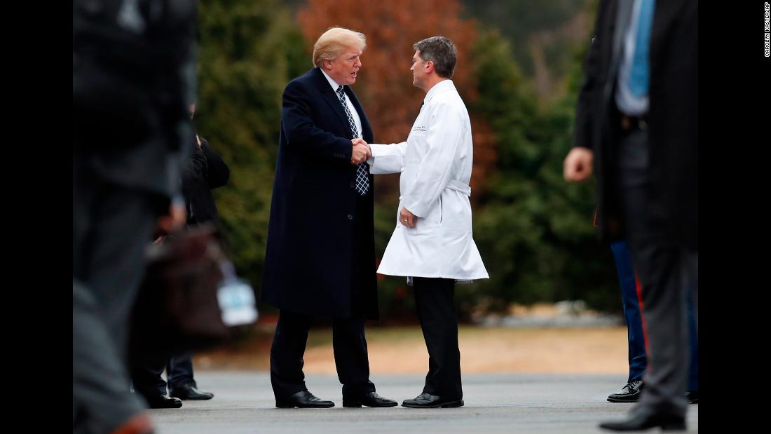 "Trump prepares to depart Walter Reed National Military Medical Center in Bethesda, Maryland, on Friday, January 12, after undergoing a physical. It was Trump's first medical checkup since becoming President. <a href=""http://www.cnn.com/2018/01/12/politics/donald-trump-medical-exam/index.html"" target=""_blank"">Dr. Ronny Jackson, the White House physician, right, said Trump is in ""excellent health.""</a>"