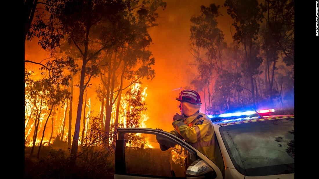 A firefighter monitors a bushfire on Sunday, January 14, in the eastern suburbs of Perth in Western Australia.<br />