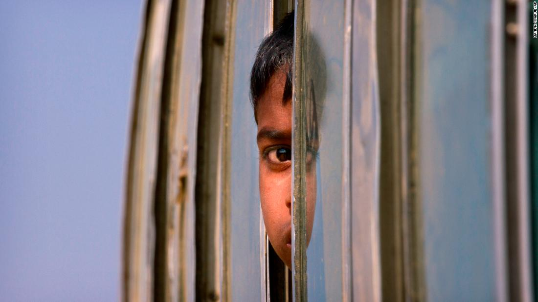 "A Rohingya refugee peers out the window of a bus as he is brought to the Balukhali refugee camp in Bangladesh on Thursday, January 18.<br />Concerns are mounting over a joint plan from<a href=""http://www.cnn.com/2018/01/17/asia/bangladesh-myanmar-rohingya-repatriation-plan-intl/index.html""> Myanmar and Bangladesh to repatriate hundreds of thousands of ethnic Rohingya</a> who fled violence in Myanmar's Rakhine state last year. The two countries plan to return more than 650,000 refugees in Bangladesh to Rakhine within two years, according to Bangladesh's Foreign Ministry."
