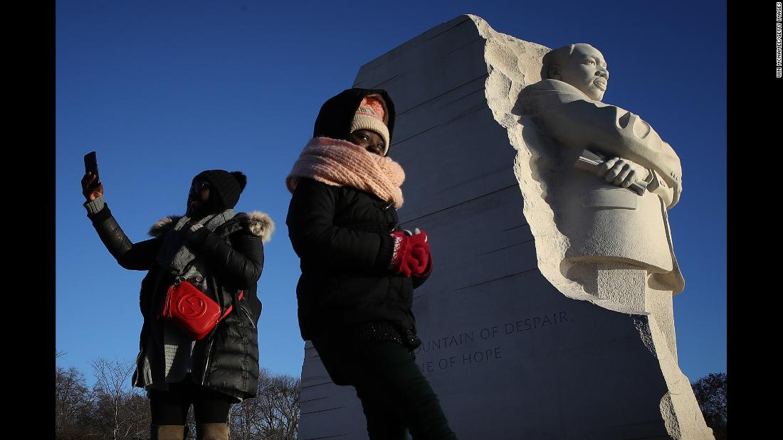 Saoudatou Dia and her daughter Aminah visit the Martin Luther King Jr. Memorial in Washington on the January 15 holiday celebrating the late civil rights leader.
