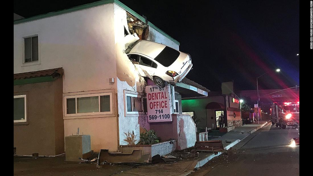 "A sedan remains wedged into the second story of a dental office in Santa Ana, California. <a href=""http://www.cnn.com/videos/us/2018/01/15/car-crashes-into-second-floor-dental-office-cabrera-nr.cnn"" target=""_blank"">The car went flying into the air after slamming into a median</a> on Saturday, January 13. Two people were taken to the hospital with minor injuries."