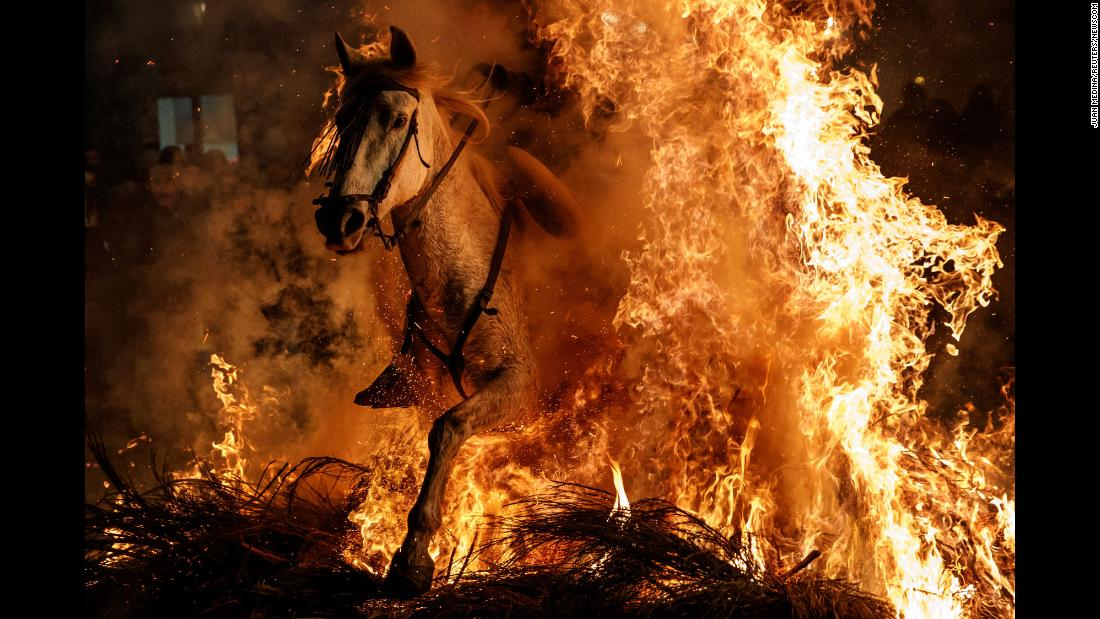 A man rides a horse through flames during the Luminarias festival in San Bartolomé de Pinares, Spain, on Tuesday, January 16. Luminarias celebrates St. Anthony, Spain's patron saint of animals.