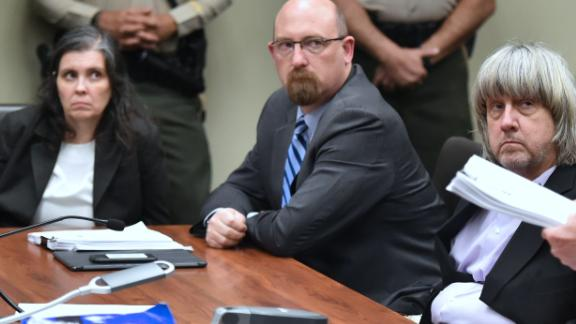 David (far right) and Louise Turpin look on Thursday with attorney Jeff Moore during the Turpins' arraignment.