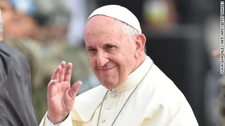 Pope Francis waves after disembarking from his plane on arrival at an air force base in Lima on January 18, 2018.  Pope Francis headed Thursday to Peru on the second leg of his South American trip, where he will meet indigenous people and hear firsthand how Peru's gold rush is destroying large areas of their Amazon homeland.  / AFP PHOTO / LUKA GONZALES        (Photo credit should read LUKA GONZALES/AFP/Getty Images)