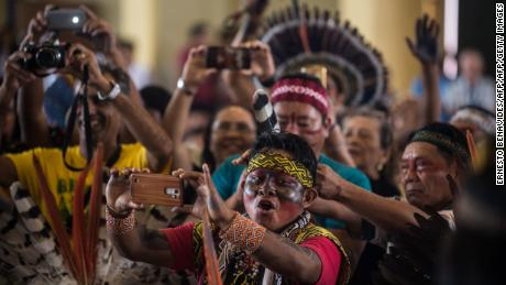 Members of indigenous communities from Peru, Brasil and Bolivia gather during the assembly of the Amazonian church in Puerto Maldonado, before the arrival of Pope Francis, on January 18, 2018.  Pope Francis will visit the cities of Puerto Maldonado, Trujillo and Lima during his upcoming visit between January 18 and 21. / AFP PHOTO / Ernesto BENAVIDES        (Photo credit should read ERNESTO BENAVIDES/AFP/Getty Images)