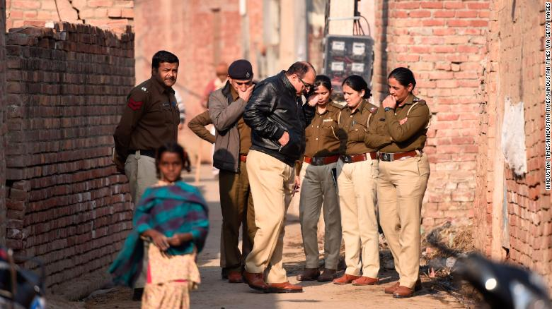 A police team arrives at the house of a 19-year old student after his body was discovered near Kirmach village in Haryana.