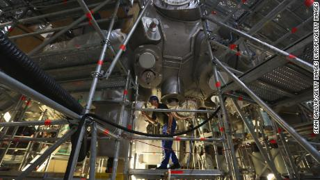 GREIFSWALD, GERMANY - OCTOBER 29:  A worker, at the photographer's request, walks on scaffolding under the Wendelstein 7-X experimental fusion reactor at the Max Planck Institute for Plasma Physics on October 29, 2013 in Greifswald, Germany. Scientists hope to heat a miniscule amount of hydrogen to 100 million degrees in order to melt the atomic cores into helium, thereby releasing large amounts of energy in a similar way as the sun. Due to be completed in 2014, the reactor could help scientists to get closer towards creating atomic fusion-based commercial power, which would be clean and virtually inexhaustible, as hydrogen comes from water.  (Photo by Sean Gallup/Getty Images)