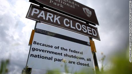 MIAMI, FL - OCTOBER 07:  A sign near the entrance to the Everglades National Park is seen indicating it is closed on October 7, 2013 in Miami, Florida. The park is closed as the United States House and Senate are into day 7 of not being able to agree on a bill to fund the United States government. National Parks around the nation are closed along with other federal services.  (Photo by Joe Raedle/Getty Images)