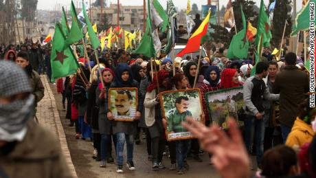 Syrian Kurds carry portraits of the Kurdistan Workers Party (PKK) leader, Abdullah Ocalan, in the town of Jawadiya on Thursday to support the region of Afrin.