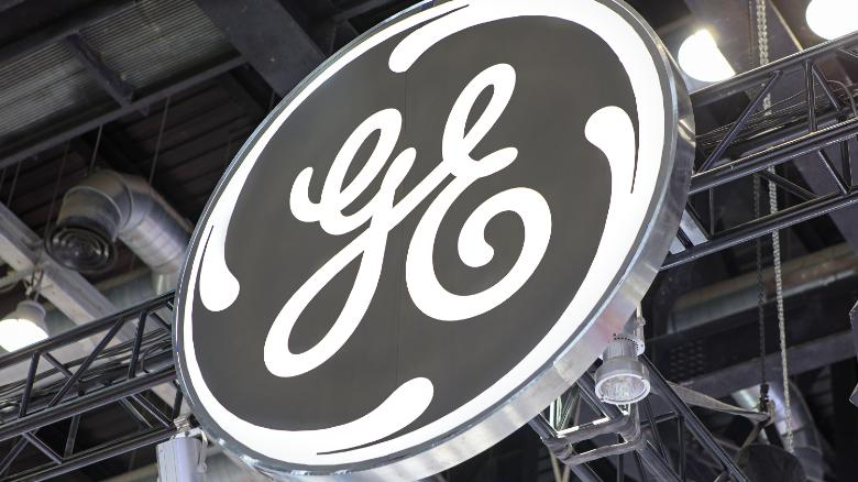 s p downgrades debt riddled ge and ge capital cnn