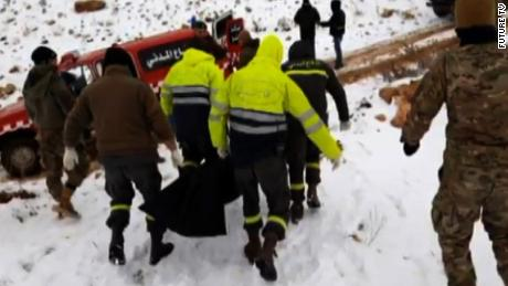 Emergency workers remove the bodies of Syrians found inside Lebanon in a mountainous region near the border.