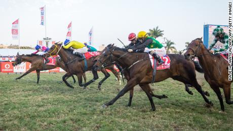Jockey Bernard Fayd'Herbe (L) wins the Durban July race riding Marinarseco at the Greyville Race Course in Durban on July 1, 2017.  The Durban July horse race is the biggest horse racing event on the African continent and a high social event where South African celebrities dress up and watch the race. It attracts close to 100,000 spectators. / AFP PHOTO / RAJESH JANTILAL        (Photo credit should read RAJESH JANTILAL/AFP/Getty Images)