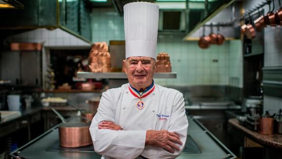 Paul Bocuse poses in the kitchen of his restaurant, l'Auberge du Pont de Collonges, near Lyon, in 2012.