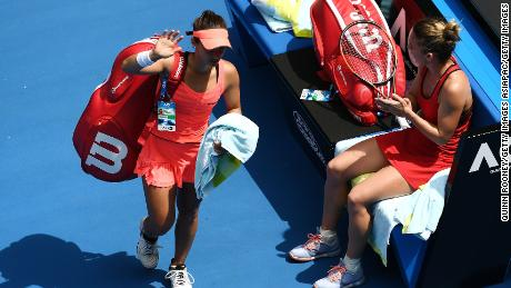 Lauren Davis is clapped off court by Halep
