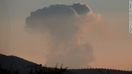 A plume of smoke rises on the air from inside Syria, as seen from the outskirts of the border town of Kilis, Turkey, Saturday, Jan. 20, 2018. Turkish Prime Minister Binali Yildirim says Turkish jets have begun an aerial offensive against the Syrian Kurdish-held enclave of Afrin. Turkey's military fired into the enclave in north Syria for a second day on Saturday. (AP Photo/Lefteris Pitarakis)