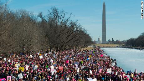 Participants in the Women's March gather near the Lincoln Memorial in Washington, Saturday, Jan. 20, 2018. On the anniversary of President Donald Trump's inauguration, people participating in rallies and marches in the U.S. and around the world Saturday denounced his views on immigration, abortion, LGBT rights, women's rights and more. (AP Photo/Cliff Owen)