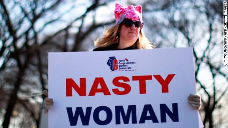 "A woman holds a sign that reads ""Nasty Woman"" -- a reference to what Donald Trump said about his opponent, Hillary Clinton, during a presidential debate -- during a demonstration in Chicago."