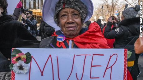 "A woman holds a sign that says ""mujer"" -- the Spanish word for ""woman"" -- during a demonstration in New York."