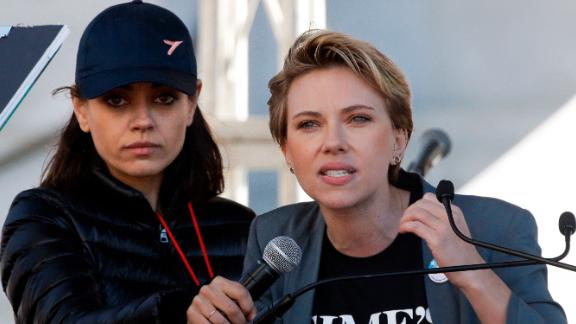 Scarlett Johansson, right, speaks as Mila Kunis holds a microphone for her at the LA Women's March.
