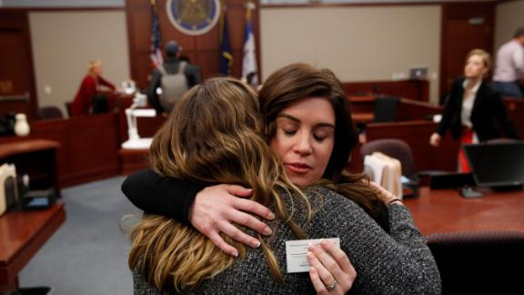 Larissa Boyce (R) gets a hug from Alexis Alvarado, both victims of Larry Nassar, during a hearing in Ingham County Circuit Court on November 22, 2017 in Lansing, Michigan. Former USA Gymnastics team doctor Lawrence (Larry) Nassar, accused of molesting dozens of female athletes over several decades, on Wednesday pleaded guilty to multiple counts of criminal sexual conduct. Nassar -- who was involved with USA Gymnastics for nearly three decades and worked with the country