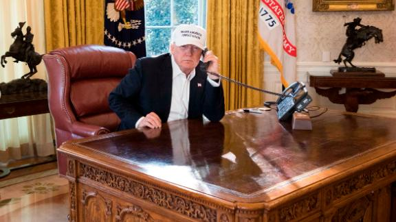 President Donald J. Trump talks on the phone in the Oval Office receiving the latest updates from Capitol Hill on negotiations to end the Democrats government shutdown, Saturday, January 20, 2018, at the White House in Washington, D.C.