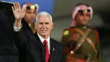 US Vice President Mike Pence waves after leaving Air Force Two upon his arrival in the Jordanian capital Amman, late on January 20, 2018.