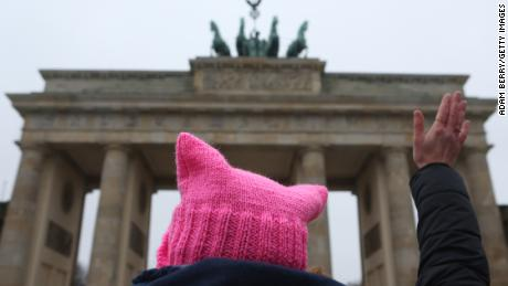 "An activist with a ""pink pussy hat"" participates in front of the Brandenburg Gate in a demonstration for women's rights on January 21, 2018 in Berlin, Germany."