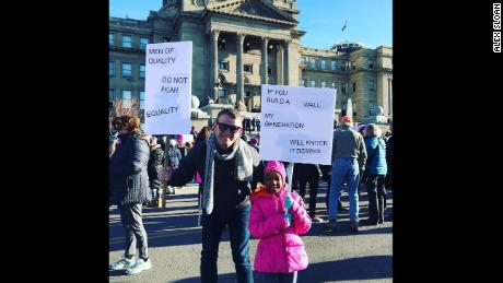 Alex Sloan joins the Women's March with his daughter in Boise, Idaho.