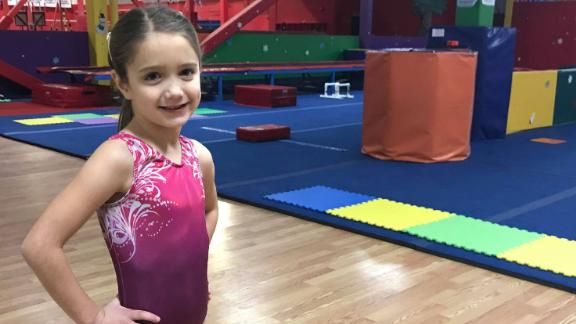 Julia Fragoso, 6, is the daughter of a former gymnast. Her mother says in light of the Nassar abuse scandal, she wouldn