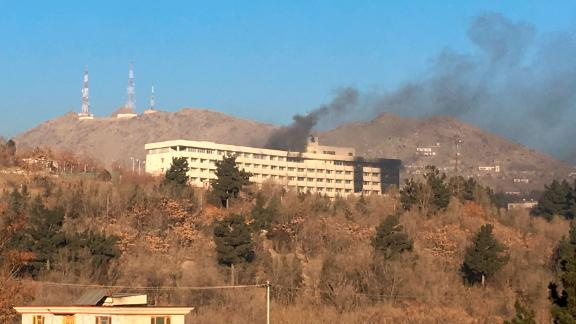 Smokes rises from the Intercontinental Hotel after an attack in Kabul, Afghanistan, Sunday, Jan. 21, 2018. Gunmen stormed the hotel in the Afghan capital on Saturday evening, triggering a shootout with security forces, officials said. (AP Photo/Rahmat Gul)