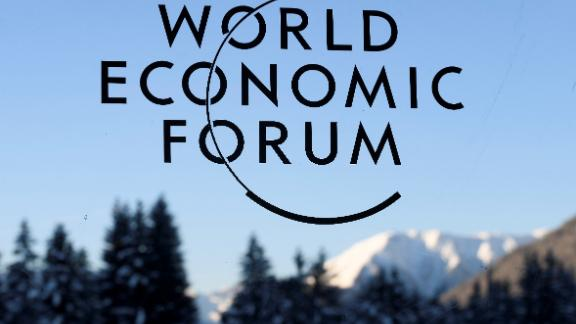 A sign and logo of the World Economic Forum is seen on the third day of the Forum