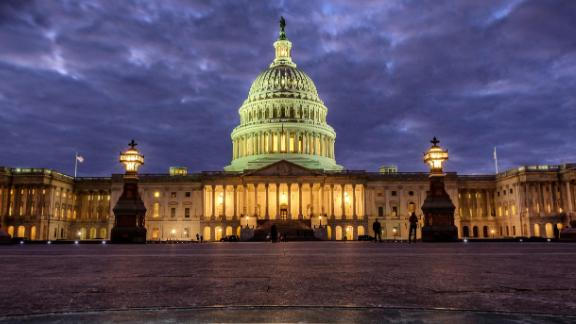 Lights shine inside the U.S. Capitol Building as night falls in Washington, Sunday, Jan. 21, 2018 and Congress continues to negotiate during the second day of the federal government shutdown. (AP Photo/J. David Ake)