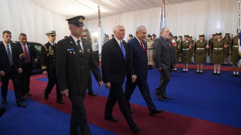Pence (L) and Netanyahu attending a welcome ceremony at the Israeli Prime Minister's office on Monday.