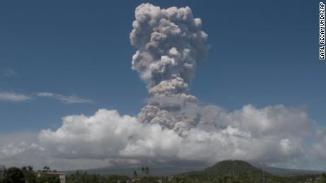 A huge column of ash shoots up to the sky during the eruption of Mayon volcano Monday, Jan. 22, 2018 as seen from Legazpi city, Albay province, around 340 kilometers (200 miles) southeast of Manila, Philippines. The Philippines' most active volcano erupted Monday prompting the Philippine Institute of Volcanology and Seismology to raise the Alert level to 4 from last week's alert level 3. (AP Photo/Earl Recamunda)