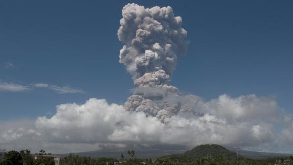 A huge column of ash shoots up to the sky during the eruption of Mayon volcano Monday, Jan. 22, 2018.