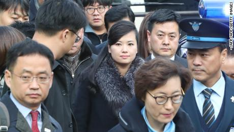Hyon Song-Wol (C), the leader of North Korea's popular Moranbong band, arrives at Seoul station in Seoul on January 21, 2018 before boarding a train bound for the eastern city of Gangneung. North Korean delegates arrived in Seoul on January 21 on their way to inspect venues and prepare cultural performances for next month's Winter Olympics, in the first visit by Pyongyang officials to the South for four years. / AFP PHOTO / KOREA POOL / - / South Korea OUT        (Photo credit should read -/AFP/Getty Images)